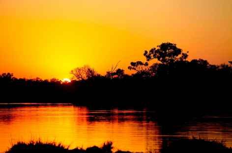 Coucher de soleil sur la rivière Okavango - Botswana -